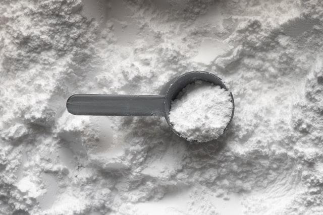white creatine monohydrate powder